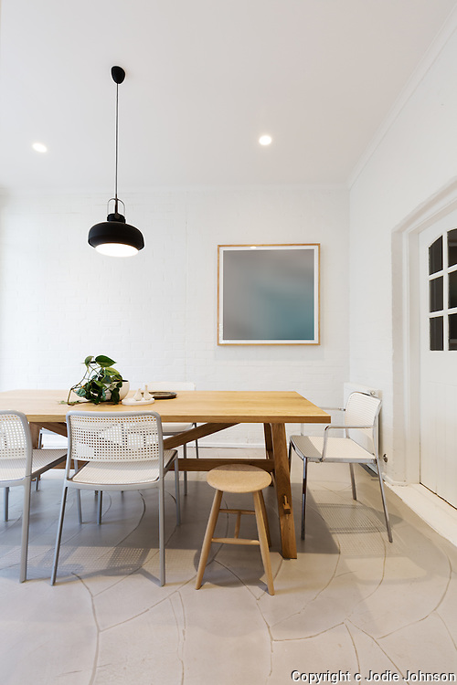Modern scandinavian styled interior dining room with pendant light in Australia