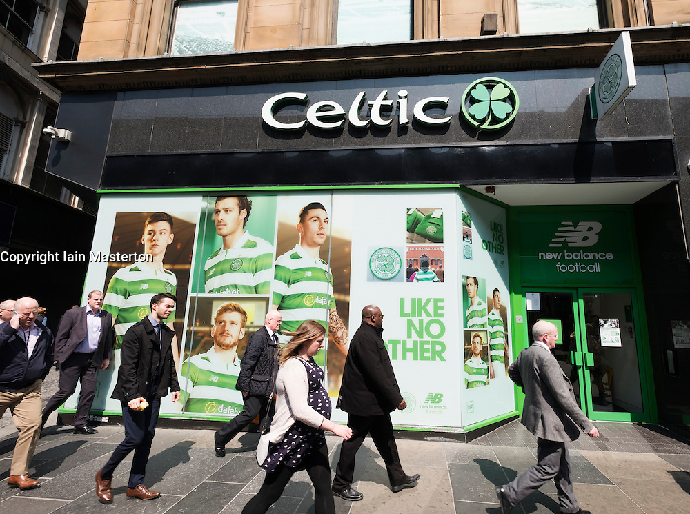 Celtic fans shop on Argyll Street in Glasgow United Kingdom