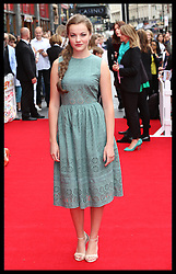 Image licensed to i-Images Picture Agency. 13/07/2014. London, United Kingdom. Izzy Meikle-Small  at the World premiere of Pudsey The Dog : The Movie in London.  Picture by Stephen Lock / i-Images