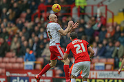 Sheffield United forward, on loan from Derby County, Conor Sammon wins the header above Coventry City defender Aaron Martin  during the Sky Bet League 1 match between Sheffield Utd and Coventry City at Bramall Lane, Sheffield, England on 13 December 2015. Photo by Simon Davies.