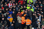 Tensions in the away end with a couple of Exeter fans getting upset with the stewards during the EFL Sky Bet League 2 match between Plymouth Argyle and Exeter City at Home Park, Plymouth, England on 11 February 2017. Photo by Graham Hunt.
