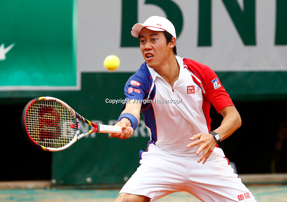 French Open 2013, Roland Garros,Paris,ITF Grand Slam Tennis Tournament,Kei Nishikori (JPN),<br /> Aktion,Einzelbild,Halbkoerper,Querformat,