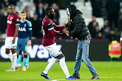 A second pitch invader, this time in a Halloween mask, is stopped by Arthur Masuaku of West Ham United - Mandatory by-line: Robbie Stephenson/JMP - 31/10/2018 - FOOTBALL - London Stadium - London, England - West Ham United v Tottenham Hotspur - Carabao Cup
