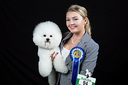 © Licensed to London News Pictures. 10/03/2016. Birmingham, UK. Charlie Barber with her Bichon Frise named Tidy at Crufts 2016 held at the NEC in Birmingham, West Midlands, UK. The world's largest dog show, Crufts is this year celebrating it's 125th anniversary. The annual event is organised and hosted by the Kennel Club and has been running since 1891. Photo credit : Ian Hinchliffe/LNP