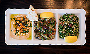 The Meze Plate — hummus, eggplant salad, and tabbouleh — at Meze Mediterranean Cuisine in Sun Praire, WI on Thursday, May 2, 2019.