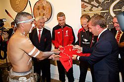 ADELAIDE, AUSTRALIA - Sunday, July 19, 2015: Liverpool's manager Brendan Rodgers signs a shirt for Karl Winda Telfe of Aboriginal dance group Paitya during a visit to the Art Gallery of South Australia ahead of a preseason friendly match against Adelaide United on day seven of the club's preseason tour. (Pic by David Rawcliffe/Propaganda)