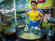 04 OCTOBER 2016 - BANGKOK, THAILAND: A vendor makes vegetarian fried noodles during the Vegetarian Festival at the Chit Sia Ma Chinese shrine in Bangkok. The Vegetarian Festival is celebrated throughout Thailand. It is the Thai version of the The Nine Emperor Gods Festival, a nine-day Taoist celebration beginning on the eve of 9th lunar month of the Chinese calendar. During a period of nine days, those who are participating in the festival dress all in white and abstain from eating meat, poultry, seafood, and dairy products. Vendors and proprietors of restaurants indicate that vegetarian food is for sale by putting a yellow flag out with Thai characters for meatless written on it in red.     PHOTO BY JACK KURTZ