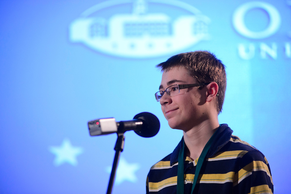 Kyle Schroeder, a 14-year-old student from St. Brendon School, smiles after he spells a word correctly during the final round of the Columbus Metro Regional Spelling Bee Saturday, March 16, 2013. Schroeder, the Columbus Metro area spelling bee winner and Matthew Pitcock, the Southeastern Ohio region spelling bee winner, will be attending the Scripps National Spelling Bee held near Washington, D.C from May 28-30, 2013.