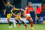 Luton Town midfielder George Moncur (20) controls the ball, watched by Oxford United defender Jamie Hanson (6) and Oxford United defender Nico Jones (46) during the EFL Sky Bet League 1 match between Luton Town and Oxford United at Kenilworth Road, Luton, England on 4 May 2019.