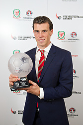 CARDIFF, WALES - Monday, October 6, 2014: Wales' Player of the Year 2014 Gareth Bale with his trophy at the FAW Footballer of the Year Awards 2014 held at the St. David's Hotel. (Pic by David Rawcliffe/Propaganda)