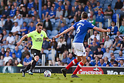 Peterborough United Midfielder, Danny Lloyd (10) takes on Portsmouth Defender, Christian Burgess (6) during the EFL Sky Bet League 1 match between Portsmouth and Peterborough United at Fratton Park, Portsmouth, England on 5 May 2018. Picture by Adam Rivers.