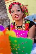 Traditional costumed folk dancer during the Day of the Dead Festival known in spanish as Día de Muertos on October 26, 2014 in Oaxaca, Mexico.