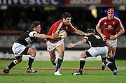 Mike Phillips of the Lions gets through a gap with Keegan Daniel of the Sharks trying to stop him.<br /> Rugby - 090610 - British&Irish Lions v Sharks - ABSA Stadium - Durban - South Africa. The Lions won 37 -3.<br /> Photographer : Anton de Villiers / SASPA