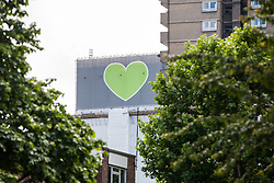 London, UK. 14 June, 2019. The Grenfell Tower on the occasion of a silent walk by family members to lay tributes at the foot of the Grenfell Tower following a memorial service at St Helen's Church to mark the second anniversary of the Grenfell Tower fire on 14th June 2017 in which 72 people died and over 70 were injured.