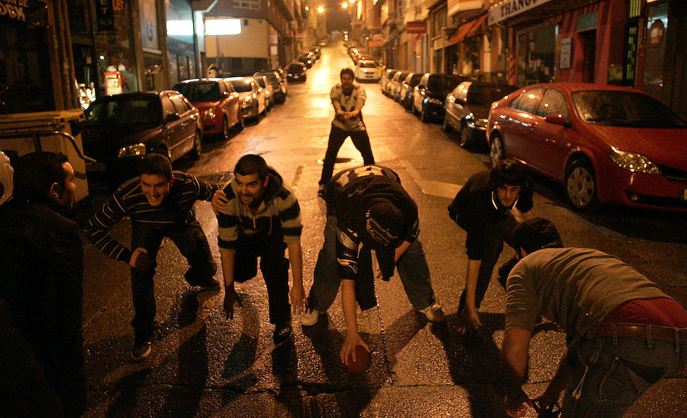 (A Coruña, Spain - February 8, 2009) - The Galician Black Towers play street football during halftime of Super Bowl XLIV early Monday morning. In most of Western Europe the game is shown only at select bars and kicks off at midnight.  ..Photo by Will Nunnally / Will Nunnally Photography