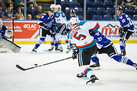 KELOWNA, CANADA - AUGUST 31: Cayde Augustine #5 of the Kelowna Rockets takes a slap shot during first period against the Victoria Royals on August 31, 2018 at Prospera Place in Kelowna, British Columbia, Canada.  (Photo by Marissa Baecker/Shoot the Breeze)  *** Local Caption ***