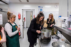 Pictured: Aileen Campbell coule not resist have a good look at the home made soup which was available to the users of the Hub cafe<br />