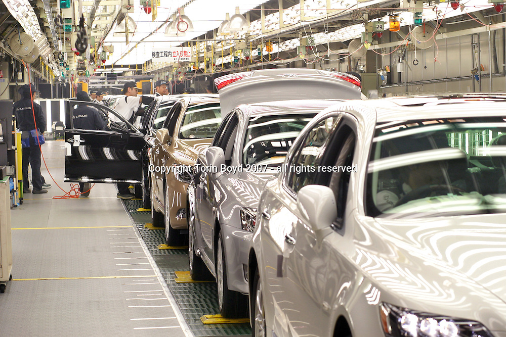 This is the inspection section of the assembly line of Toyota Motor Corporation's Tahara plant located in Aichi Prefecture where Toyota manufactures its luxury Lexus sedans. Many of the cars in this photo are hybrid models. The models manufactured here include the Lexus models: LS600h (hybrid launched in Japan in May 2007), the 600hl, LS460, 460L, GS450h, 430, 350, 300, IS350 and 250. On average there are 670 vehicles manufactured here every day, which is about one car every 83 seconds coming off the line. Also unique to this plant is the rigid quality control standards that checks for scratches, imperfections, noise levels in the cab, and an extra inspection for blemishes on 36 spots using a hand held digital measuring device that takes 15 to 20 minutes for each car.