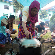 MARAWI, PHILIPPINES - JUNE 4: Displaced residents cook in a make shift tent in Municipality of Saguiaran, Lanao del Sur, Marawi City in southern Philippines, June 4, 2017. Philippine troops and Marines continue to advance their positions as more soldiers reinforce to fight the Maute group in Marawi City, Mindanao, Philippines. (Photo: Richard Atrero de Guzman/ANADOLU Agency)