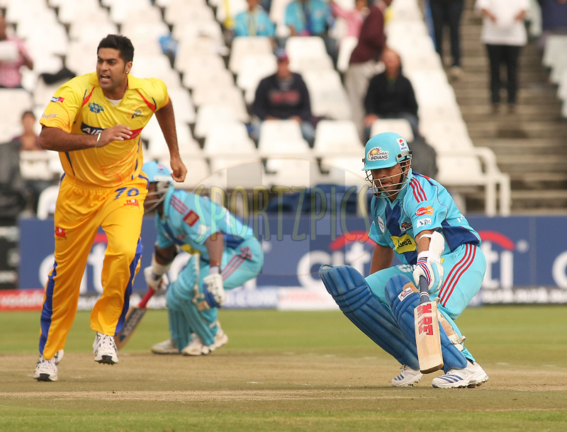 CAPE TOWN, SOUTH AFRICA - 18 April 2009. Manpreet Gony charges back to the wicket while Sachin Tendulkar looks for a second run during the opening match of the inaugural double header of the (Indian Premier League)  IPL Season 2 between The Mumbai Indians and The Chennai Superkings held at Sahara Park Newlands in Cape Town, South Africa..