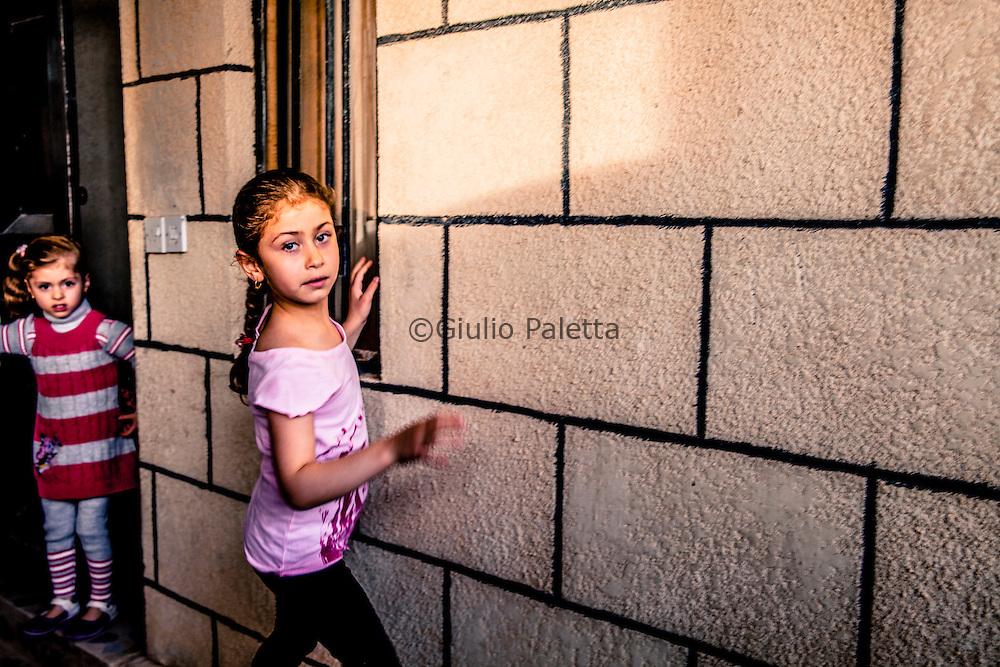 Young Yazidi girls playing in the yard