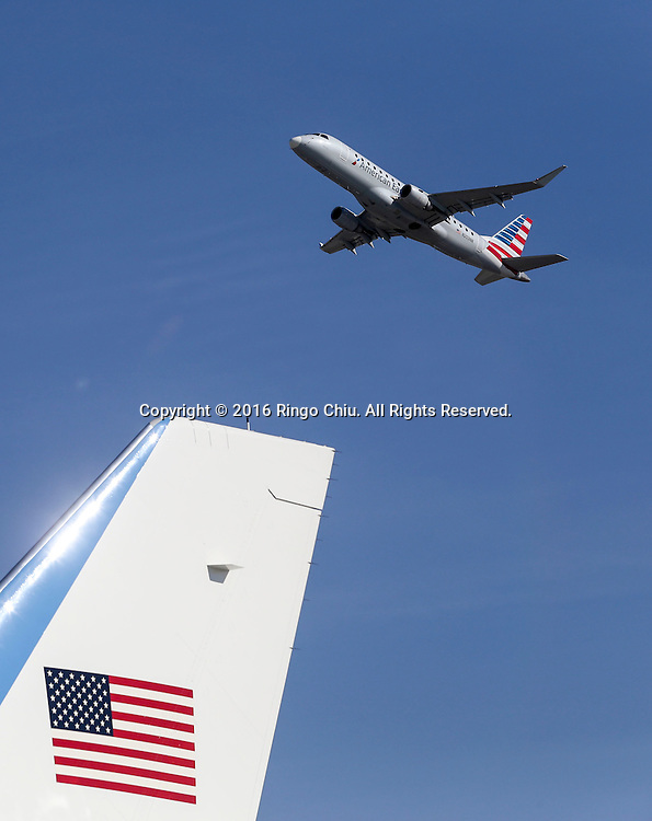An American Airline aircraft flies past Air Force One sitting on the tarmac before President Barack Obama boarding at Los Angeles International Airport in Los Angeles, Friday, Feb 12, 2016.(Photo by Ringo Chiu/PHOTOFORMULA.com)<br /> <br /> Usage Notes: This content is intended for editorial use only. For other uses, additional clearances may be required.