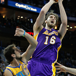 February 5, 2011; New Orleans, LA, USA; Los Angeles Lakers power forward Pau Gasol (16) shoots over New Orleans Hornets shooting guard Marco Belinelli (8) during the third quarter at the New Orleans Arena. The Lakers defeated the Hornets 101-95.  Mandatory Credit: Derick E. Hingle