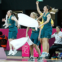 30 July 2012: Bench players of Australia celebrate during the 74-70 Team France overtime victory over Team Australia, during the women's basketball preliminary, at the Basketball Arena, in London, Great Britain.