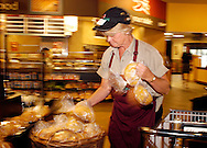 SPECIAL TO THE PHILADELPHIA DAILY NEWS: Barb Stenn, a bekery employee puts fresh baked rolls out for sale at Genuardis Tuesday, August 30, 2005 in Doylestown, Pa. (AP Photo/ William Thomas Cain)
