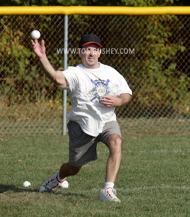 Scotchtown, New York - A player pitches the ball in the Wiffle for Kids charity Wiffle Ball tournament at the Town of Wallkill Little League fields on Sept. 25, 2010. The annual event is run by the Wallkill East Rotary.