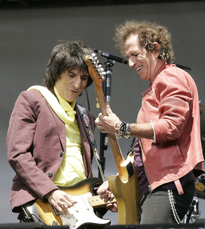 Ron Wood and Keith Richards of the Rolling Stones get together before a news conference at which they announced the new concert tour. At the Juilliard School of Music in New York Tuesday 10 May 2005.