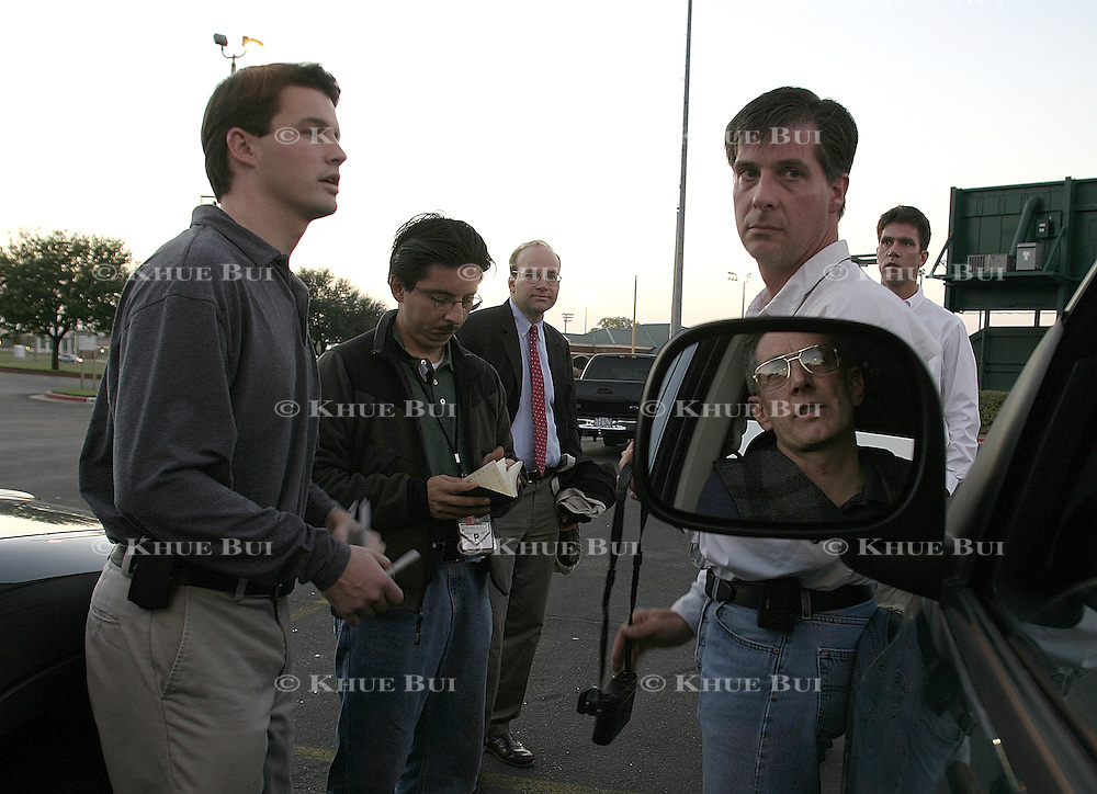 Members of the press gather at the Baylor University softball fields for an escort to Air Force One Wednesday, November 26, 2003, in Waco, TX.  President Bush made an unscheduled trip to Baghdad, Iraq.  (L-R)  Steve Atkiss,   , Associated Press photographer Pablo Martinez Monsivais, Washington Post White House correspondent Mike Allen, Time Magazine photographer Chris Usher, Bloomberg White House correspondent Dick Keil, and Reuters photographer Larry Downing (in mirror)..Photo by Khue Bui