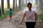 FENGQIU COUNTY, CHINA - (CHINA OUT) <br /> <br /> 5-Year-Old Girl Has Never Worn Dress Due To Her Black Patch<br /> <br /> Mengmeng, a 5-year-old girl with a giant black patch of melanocytic nevi on her midsection, walks with her mother on May 24, 2014 in Fengqiu County, Henan Province of China. After three years of infertility, Wang Yanna finally gave birth to her first child, Mengmeng, only to find a giant black patch of melanocytic nevi on her midsection. Mengmeng, 5-year-old daughter of Liu Weikai and Wang Yanna from Fengqiu County, is willing to go through pain to get rid of the patch. During a laser operation, Mengmeng cried in pain yet still would not let them stop. Although doctors were able to get rid of the lumps that formed on Mengmeng\'s black patch, none of them knew what to do with the patch itself. Since the patch may become cancerous, Mengmeng\'s parents are worried it will be a threat to their daughter\'s life. Several experts have suggested to graft off the skin but the operation would require hundreds of thousands of dollars, which is unrealistic for Mengmeng\'s family. Mengmeng currently does not go to school, only plays at her front door, and has never worn a dress. ©Exclusivepix