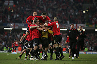 Photo: Lee Earle.<br /> Barnsley v Swansea City. Coca Cola League 1. Play off Final. 27/05/2006. Barnsley keeper Nick Colgan is mobbed by his team mates after saving Swansea's last penalty.