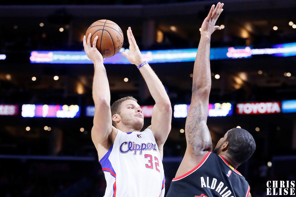 08 November 2014: Los Angeles Clippers forward Blake Griffin (32) goes for the sky hook over Portland Trail Blazers forward LaMarcus Aldridge (12) during the Los Angeles Clippers 106-102 victory over the Portland Trail Blazers, at the Staples Center, Los Angeles, California, USA.
