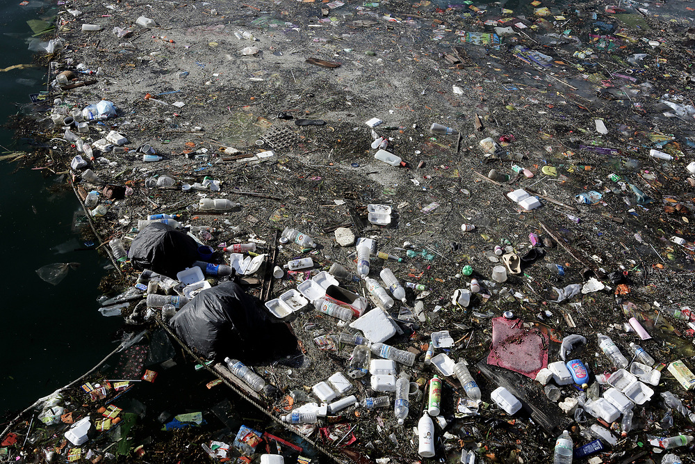 Plastic bottles and other trash floating in ocean in Semporna, Borneo, Malaysia