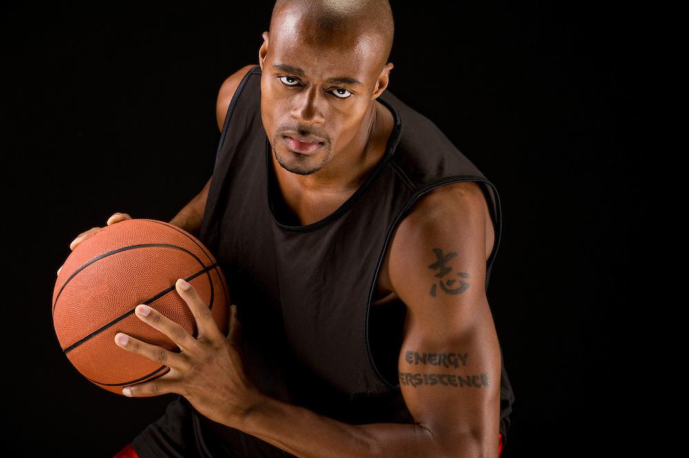 African american basketball player grabbing a ball.