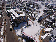 SHOT 3/2/17 12:10:09 PM - Aerial photos of Park City, Utah. Park City lies east of Salt Lake City in the western state of Utah. Framed by the craggy Wasatch Range, it's bordered by the Deer Valley Resort and the huge Park City Mountain Resort, both known for their ski slopes. Utah Olympic Park, to the north, hosted the 2002 Winter Olympics and is now predominantly a training facility. In town, Main Street is lined with buildings built primarily during a 19th-century silver mining boom that have become numerous restaurants, bars and shops. (Photo by Marc Piscotty / © 2017)