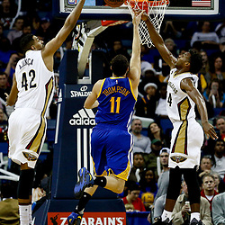 Dec 13, 2016; New Orleans, LA, USA;  New Orleans Pelicans center Alexis Ajinca (42) blocks a shot by Golden State Warriors guard Klay Thompson (11) during the second half of a game at the Smoothie King Center. The Warriors defeated the Pelicans 113-109. Mandatory Credit: Derick E. Hingle-USA TODAY Sports