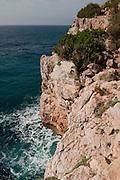 Cliffs at Moraig Beach area. Banitachell village, Alicante province, Costa Blanca, Spain, Europe.