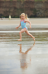© Licensed to London News Pictures. 24/07/2012..Saltburn Beach, Cleveland, England..As temperatures rise visitors to the beach in the seaside town of Saltburn by the Sea in Cleveland enjoy their day. ..Scarlet Harding, 3 can't wait to get into the water...Photo credit : Ian Forsyth/LNP