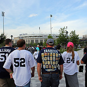 Fans arrive at Yankee stadium for the New York Yankees V New York Mets Subway Series Baseball game at Yankee Stadium, The Bronx, New York. 8th June 2012. Photo Tim Clayton