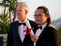 Director Qiu Yang, winner of the award for Best Short Film for A Gentle Night (Xiao Cheng Er Yue) and Teppo Airaksinen winner of special mention for his short film 'The Ceiling (Katto) at the Award Winner's Photocall at the 70th Cannes Film Festival Saturday 27th May 2017, Cannes, France. Photo credit: Doreen Kennedy