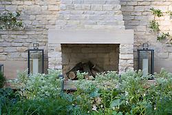 Outdoor fireplace in the Daylesford Organic Summer Solstice Garden.