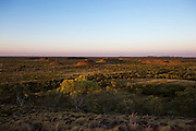 The rising sun washes soft golden light across the landscape around Tennant Creek as viewed from the Bill Allen lookout.