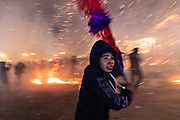 A Mexican man runs for cover as he is barraged by pyrotechnic sky rockets during the Alborada festival September 29, 2018 in San Miguel de Allende, Mexico. The unusual festival celebrates the cities patron saint with a two hour-long firework battle at 4am representing the struggle between Saint Michael and Lucifer.