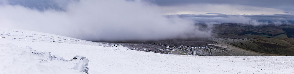 Cheviot Hills, Yetholm, UK. 13th January 2016. Looking west from the Cheviot Auchope Cairn (726m) as cloud moves across the Anglo Scot Border.