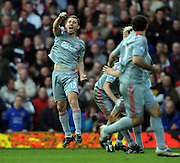 Fabio Aurelio of Liverpool celebrates scoring their third goal during the Barclays Premier League match between Manchester United and Liverpool at Old Trafford on March 14, 2009 in Manchester, England.