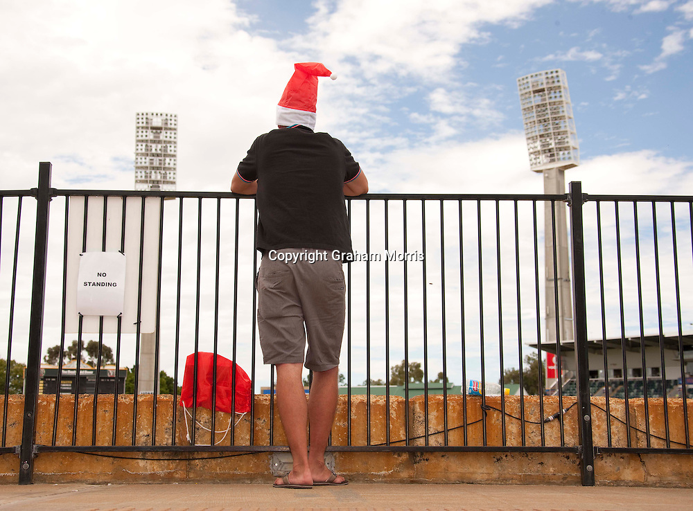 A lone England fan in a Santa hat after losing the third Ashes test match against Australia at the WACA (West Australian Cricket Association) ground in Perth, Australia. Photo: Graham Morris (Tel: +44(0)20 8969 4192 Email: sales@cricketpix.com) 19/12/10