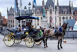 A horse and trap in Grote Markt, Bruges, Belgium<br /> <br /> (c) Andrew Wilson | Edinburgh Elite media